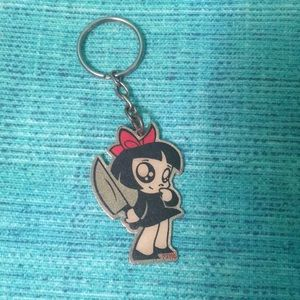 Girl with red bow keychain